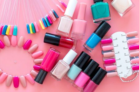 Ð¡hoose nail polish. Polishes and color samples on pink background top view mockup copy space Stok Fotoğraf