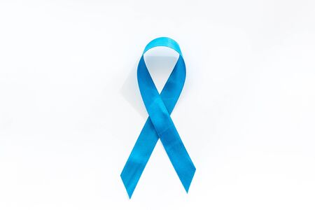 Blue ribbon as symbol disease control on white background top view copy space Stockfoto