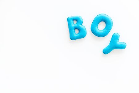 Boy word as decoration for baby shower on white background top view frame copy space Stock Photo