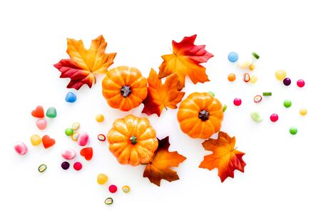 Halloween composition with sweets on white background top view