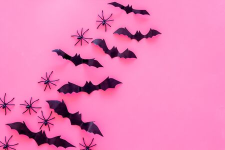 Stylish Halloween design. Bats and spiders on pink background top view copy space Stock Photo