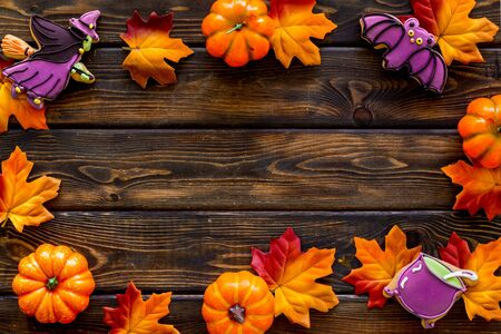 Nice halloween background with sweets. Cookies and pumpkins on dark wooden top view frame copy space Stok Fotoğraf