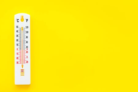 Weather thermometer on yellow background top view. Stock Photo