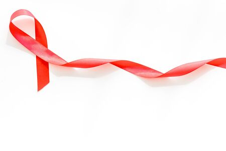 AIDS disease. Red ribbon on white background top view space for text Banco de Imagens