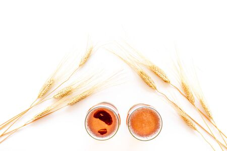 Barley or wheat as beer ingredient near beer glasses on white background top view copy space Stock Photo