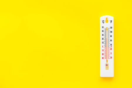 Weather thermometer on yellow background top view copy space Stock Photo