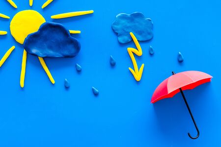 Weather forecast concept. Sunny and rainy. blue background top view copy space