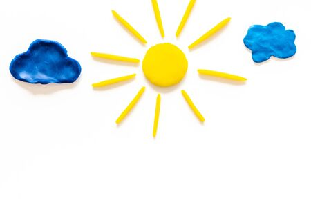 Cloudly weather concept. Sun and clouds on white background top view copy space Stock Photo