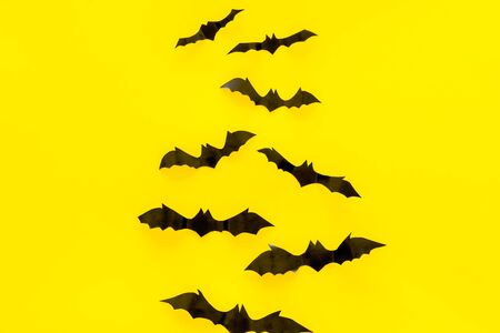 Halloween design. Bats on yellow background top view space for text