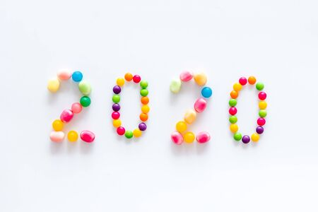 Sweet New Year design. 2020 laid out with candy on white background top view copy space 写真素材
