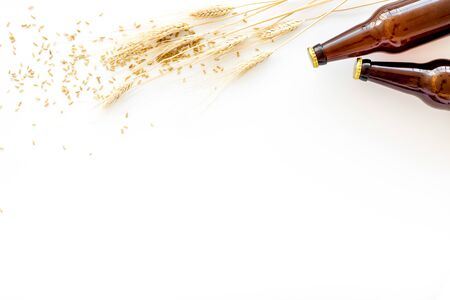 Beer background with barley on white background top view copy space Stock Photo - 131087070
