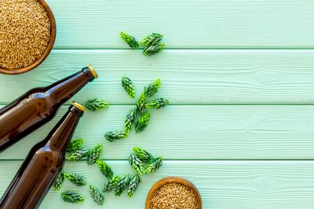 Barley and hop for making beer on green wooden background top view copy space Stock Photo