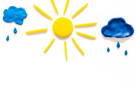 Weather forecast concept. Sunny and rainy. white background top view copy space