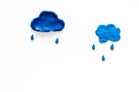 Rain concept. Clouds and drops on white background top view copy space