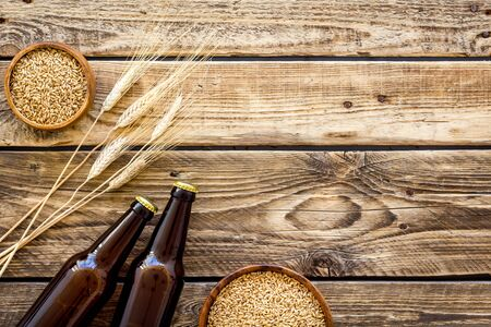 Beer background with barley on rustic wooden background top view copy space