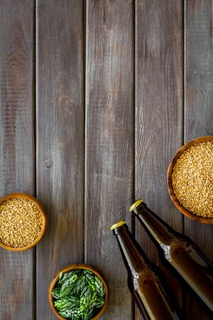 Barley and hop for making beer on dark wooden background top view copy space Stock Photo