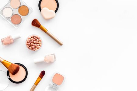 Makeup concept. Frame with decorative cosmetics and brushes on white background top view copy space
