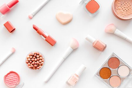 Makeup set with powder, rouge and brusheson white background top view pattern 写真素材