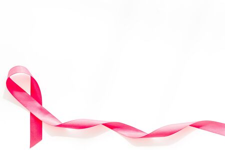Pink ribbon as symbol of breast cancer awareness on white background top view. Archivio Fotografico - 131700520