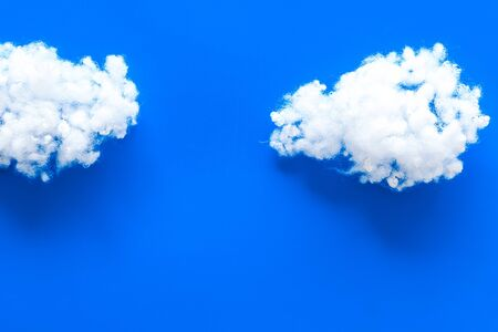 Cloudly weather concept. Clouds on blue background top view. Stock fotó