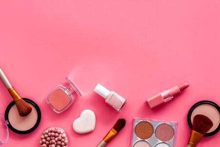 Makeup concept. Frame with decorative cosmetics and brushes on pink background top view. Stock fotó