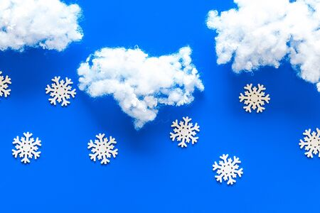 Its snowing concept. Snow and clounds on blue background top view copy space Stock Photo