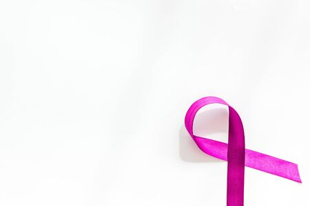 Lavender ribbon is symbol of Alzheimers disease on white background top view copy space