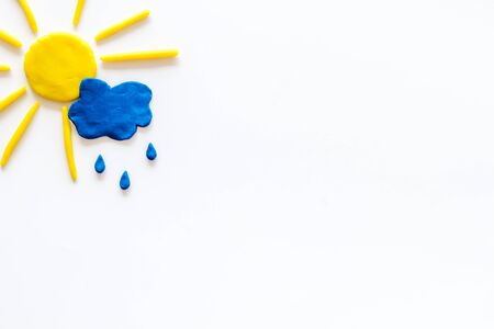 Weather forecast concept. Sunny and rainy. white background top view space for text Stock Photo