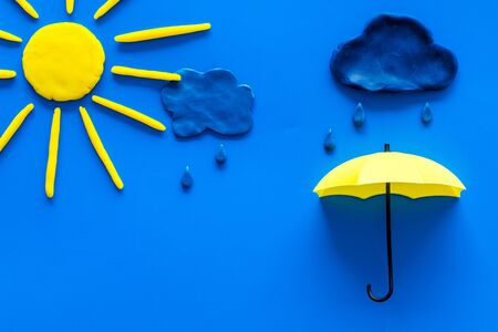 Weather forecast concept. Sunny and rainy. blue background top view. Stock Photo