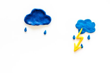 Storm concept, bad weather. Clouds and lightning on white background top view. Stock Photo