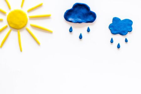 Weather forecast concept. Sunny and rainy. white background top view.
