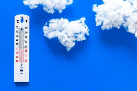 Weather thermometer on blue background top view copy space Stock Photo