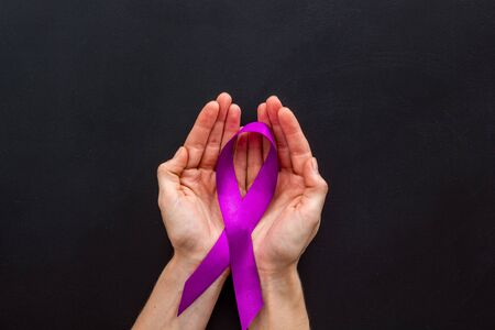 Lilac ribbon in hands is symbol of Alzheimers disease on white background top view copy space Zdjęcie Seryjne