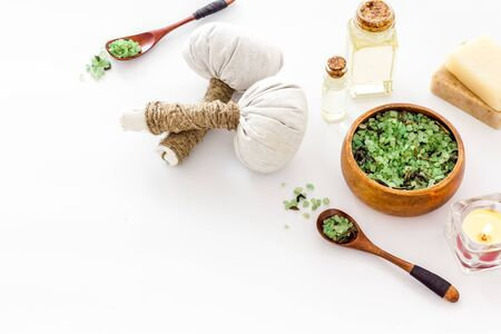 Massage thai herbal balls near spa accessories on white background. Stock Photo