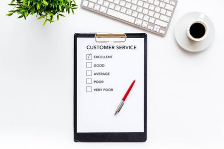 Customer service form on white office desk top view copy space