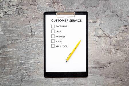 Customer service form on grey background top view. Reklamní fotografie