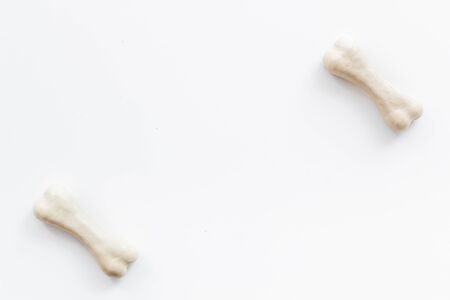 Treats for dogs. Chewing bones on white background top view copy space Reklamní fotografie