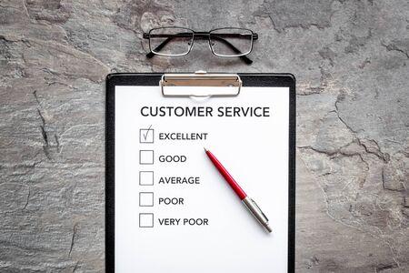 Customer service form on grey background top view copy space Reklamní fotografie