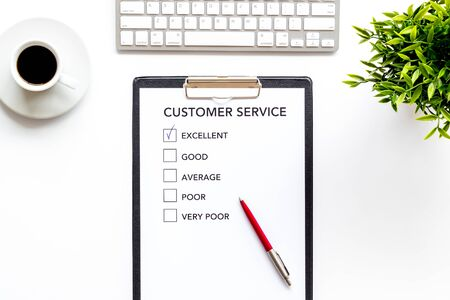 Customer service form on white office desk top view.