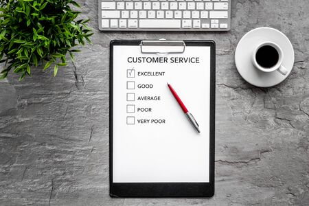 Customer service form on grey office desk top view space for text