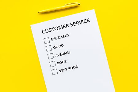 Customer service form with mark Exellent close up on yellow background top view space for text