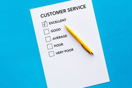Customer service form with mark Exellent close up on blue background top view copy space