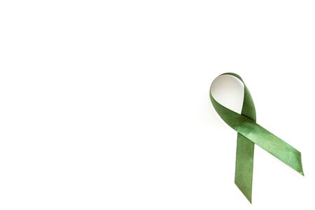 Green ribbon as symbol of disease control on white background top view.