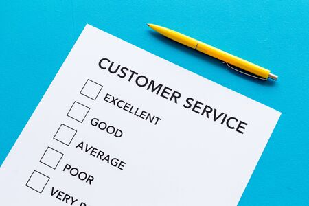 Customer service form close up on blue background top view.
