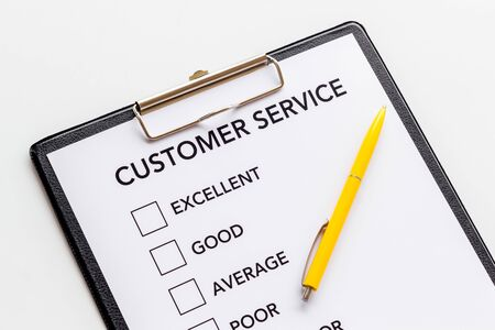 Customer service form with mark Exellent close up on white background top view. Reklamní fotografie