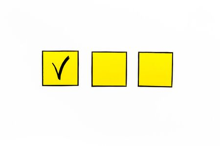 Check mark in check-box of check list on white background top view. Reklamní fotografie