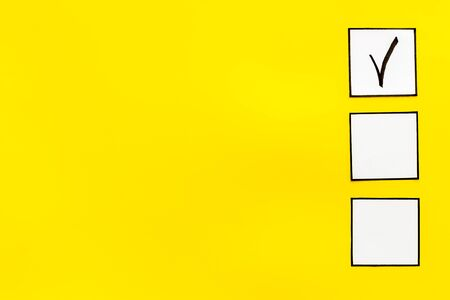 Check mark in check-box on yellow background top view space for text