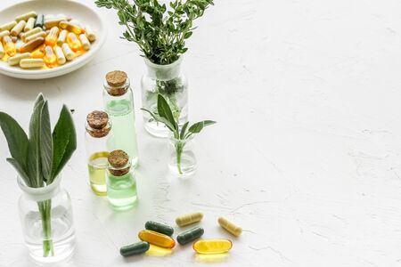 Herbal formulations for health care - herbs and drugs on white background copy space