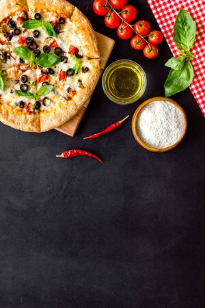 Traditional italian food: pizza on black background top view copy space