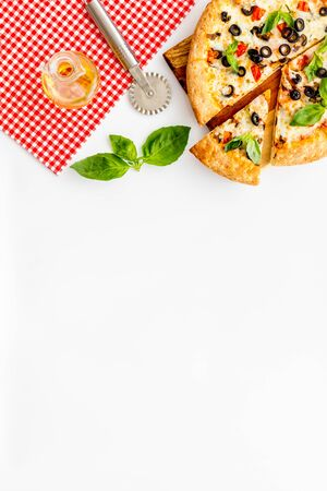 Homemade pizza on white background top view. 스톡 콘텐츠